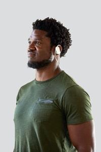 man wearing emotiv mn8 brain wave measuring data hardware neurotech