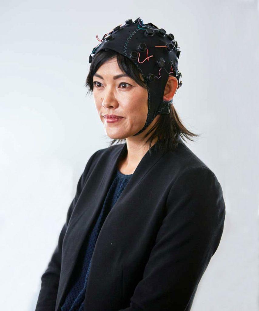 emotiv Epoc flex woman wearing headset cap brain wave measuring data hardware neurotech