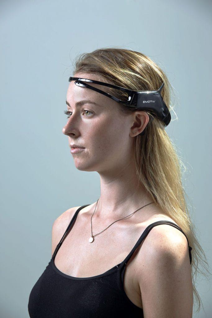 woman wearing Emotiv insight headset brain waves measuring data hardware neurotech